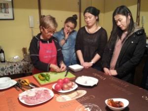 Marta at work in her living room preparing the paella ingredients